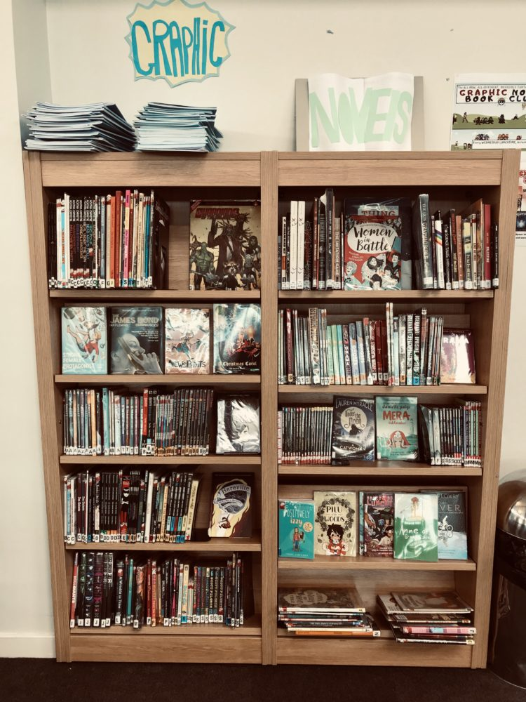 Picture of the graphic novels on their new shelves.